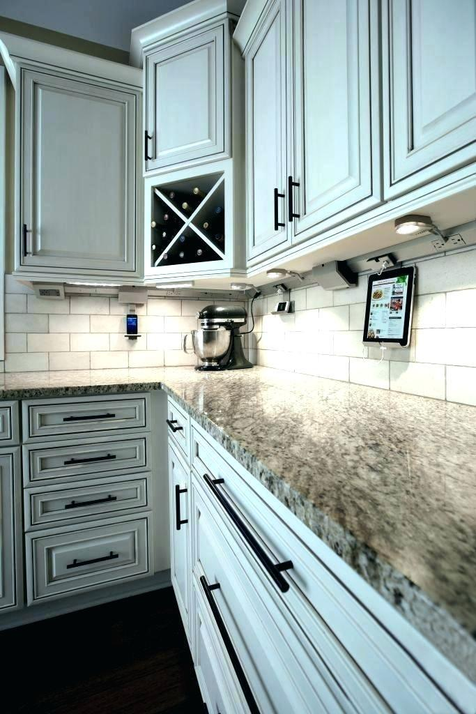 fair under cabinet lighting with integrated outlets
