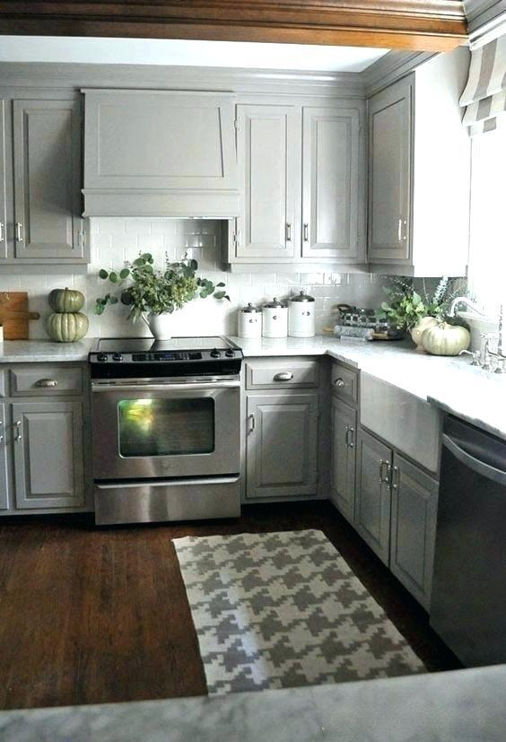 little space kitchens with gray cabinets and black appliances