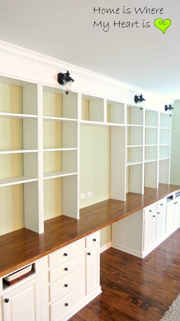 sympathetic built in shelves and cupboards