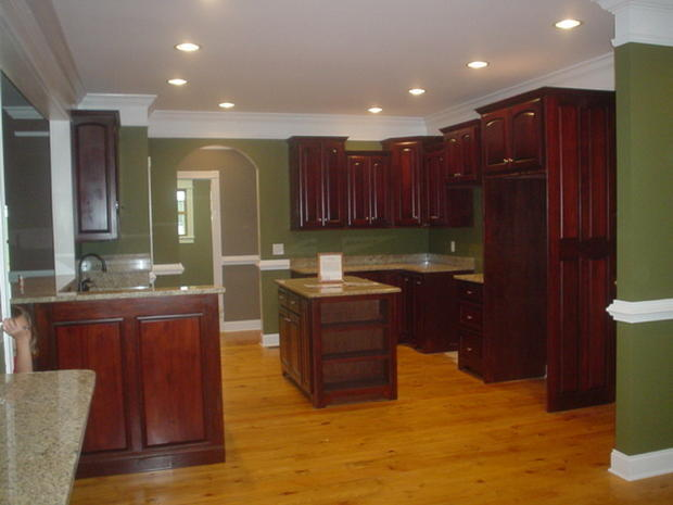little space cherry stained oak kitchen cabinets